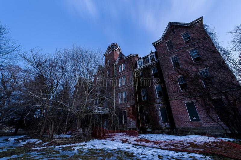 Twilight Long Exposure - Abandoned Knox County Infirmary - Knox County, Ohio. A blue hour / twilight view of the collapsing and abandoned Knox County Infirmary royalty free stock photos