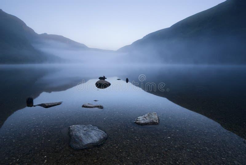 Twilight at mountain lake stock photos