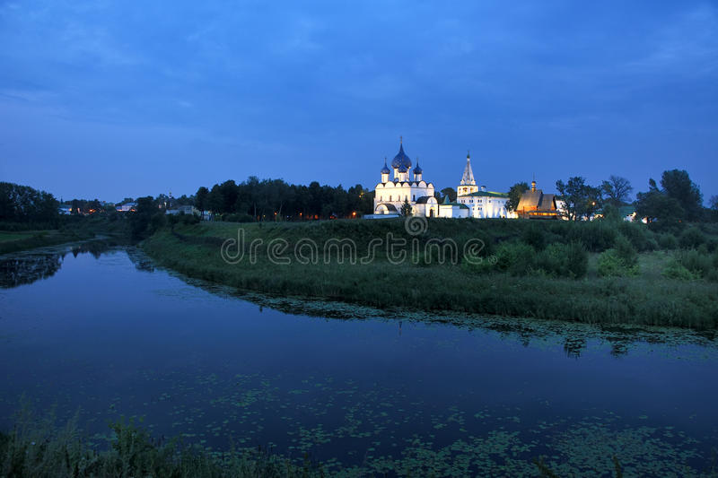 Twilight over Kamenka River and Suzdal Kremlin in Summer royalty free stock image