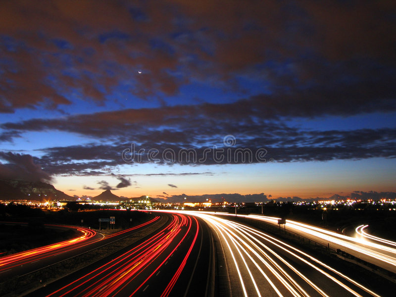 Twilight road. A busy city highway at twilight