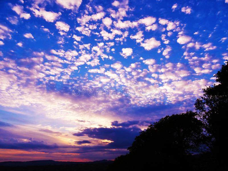 Twilight scatter clouds stock image