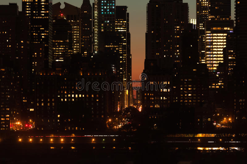 Twilight scene detail of buildings at Midtown Manhattan in NYC. Twilight scene detail of Midtown Manhattan skyscrapers, FDR drive and East 57th Street in New stock photography