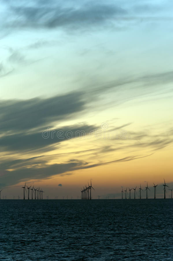 Twilight skies and windmill farm royalty free stock images