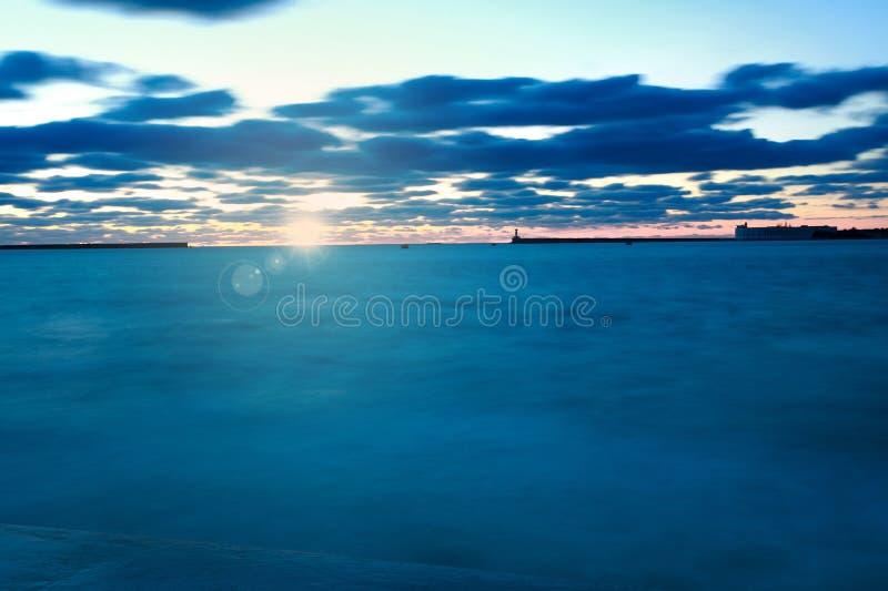Twilight sky above the blue sea on background of rising sun. Twilight sky above the blue sea on background of the rising sun stock photos