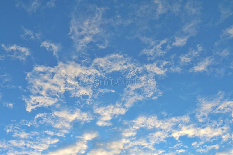 Twilight sky evening time, sunshine yellow gold on cloud blue sky background royalty free stock images
