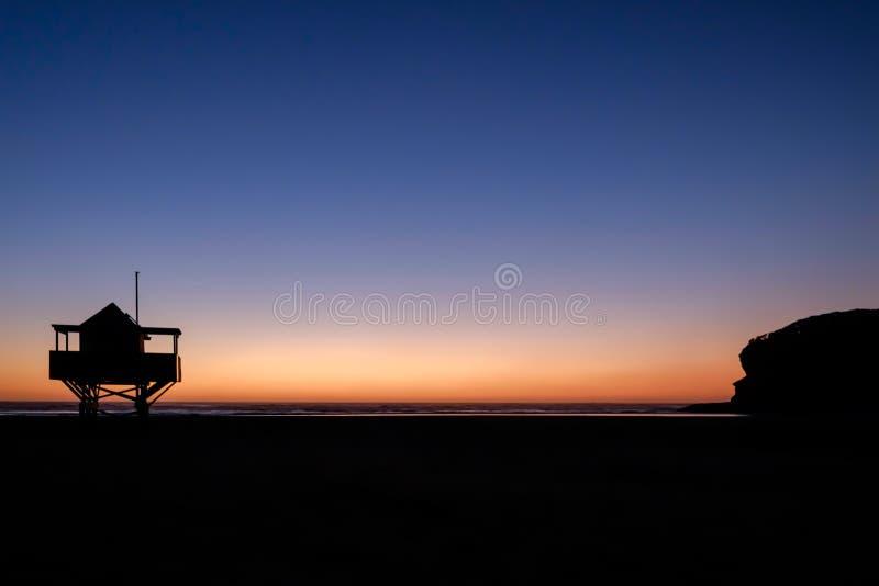 Twilight sunset at beach stock photography