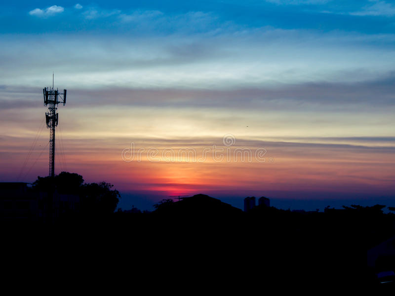 Twilight time of bangkok cityscape with radio pole silhouette stock images