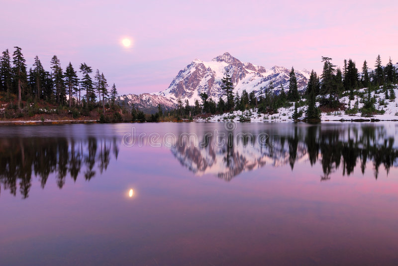 Twilight Time in Picture Lake. Picture Lake reflection of Mount Shuksan with snow royalty free stock photo