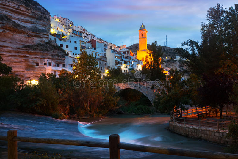 Twilight view of Alcala del Jucar with bridge. Spain royalty free stock photography