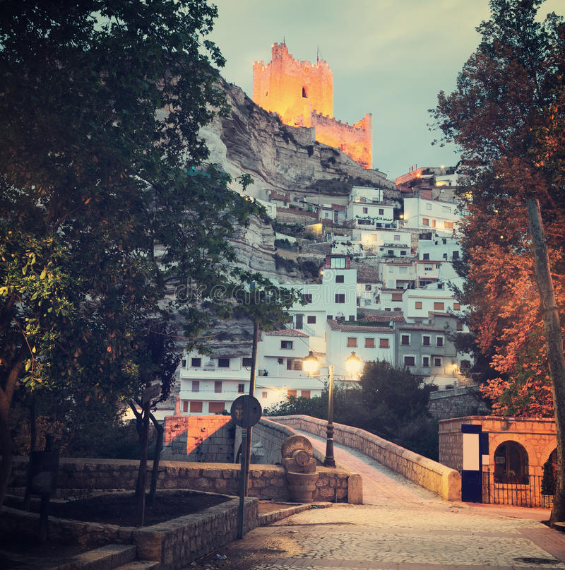 Twilight view of Alcala del Jucar with castle and bridge. Province of Albacete, Spain royalty free stock photos