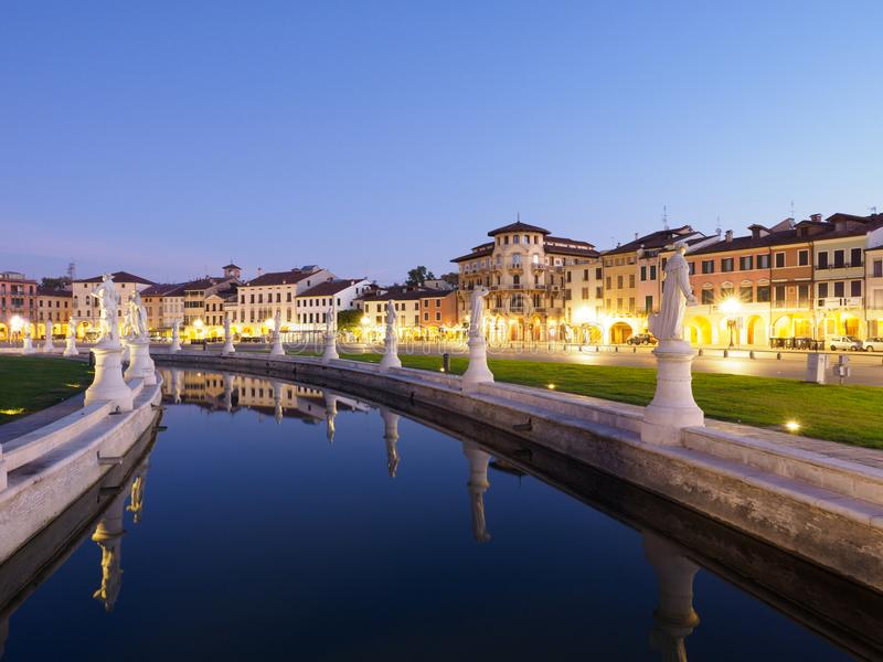 Prato della Valle Square in Padova, Italy at night. Twilight view of market square Prato della valle and canal with full moon at Padova, Italy royalty free stock photography