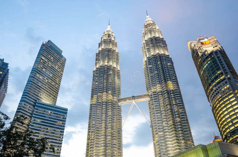 Twilight view of the Petronas Twin Towers and Suria mall in the Malaysian capital, Kuala Lumpur. KUALA LUMPUR, MALAYSIA - JUNE 10, 2015: Twilight view of the stock photography
