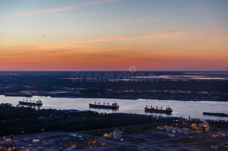 Twilight view of refinery and 4 tankers. Twilight view of refinery and tankers royalty free stock photos