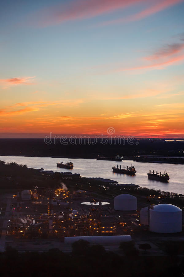 Twilight view of refinery and tankers. Twilight view of refinery and 3 tankers stock photos