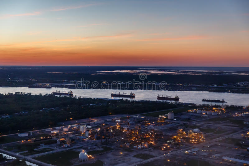 Twilight view of refinery and tankers. Twilight view of refinery and several oil tankers royalty free stock photography