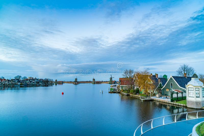 Twilight view of typical dutch houses with windmills and the River Zaan. At Zaanse Schans Netherlands royalty free stock photo
