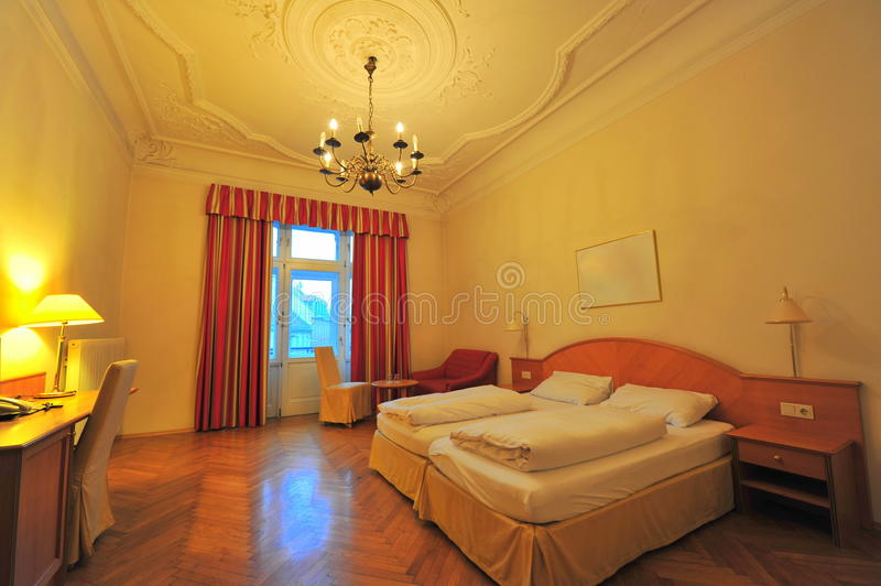 Twin beds hotel room interior. Hotel room interior with twin beds furnished and decorated in a retro architectural style stock photography