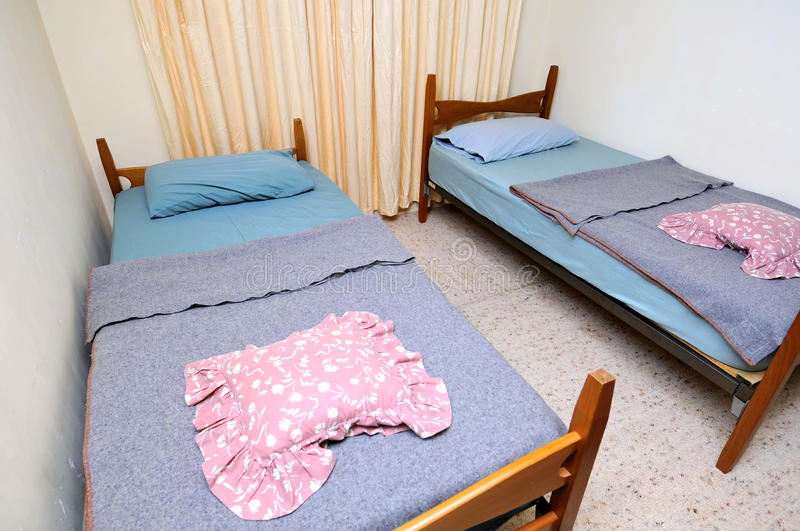 Twin beds in simple motel room stock photos