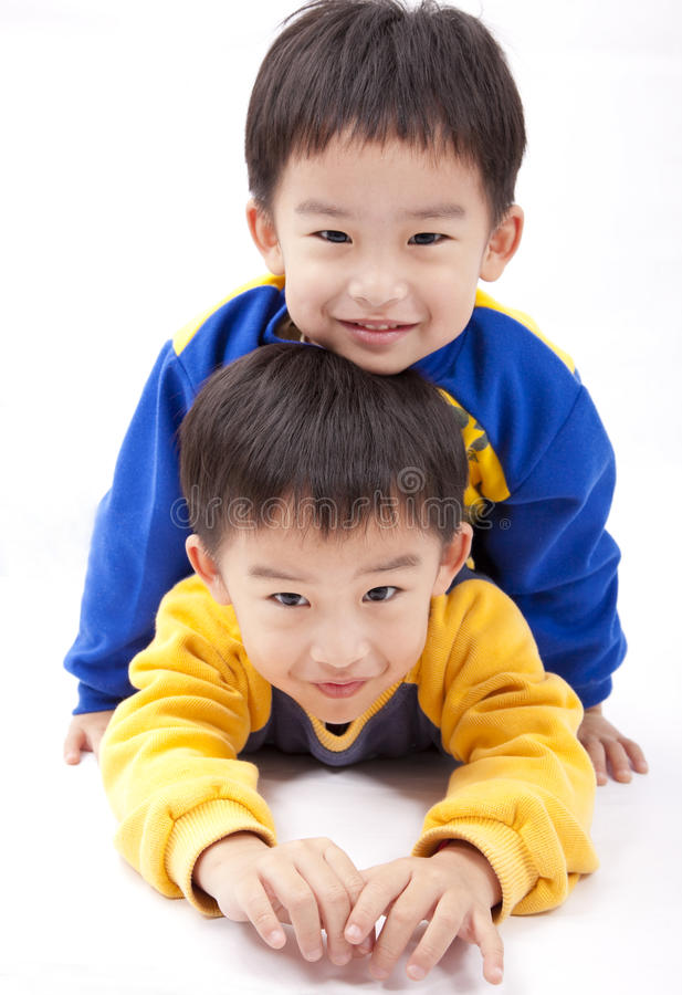 Twin brothers. Two happy boys royalty free stock image