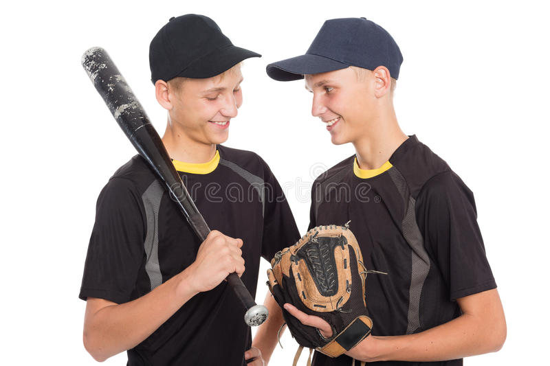 Twin brothers guys in the form of a baseball game royalty free stock images