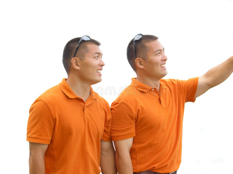Twin brothers looking stock images