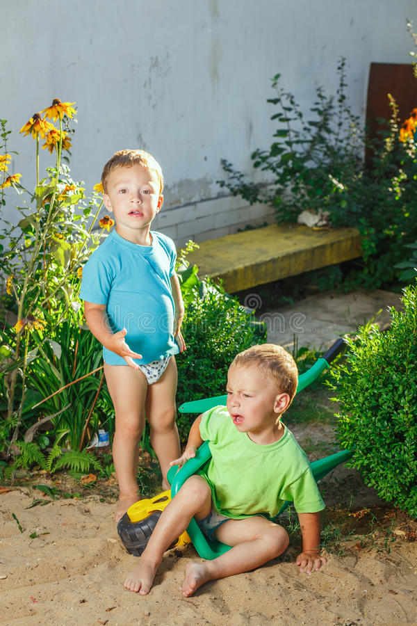 Twin brothers playing royalty free stock images