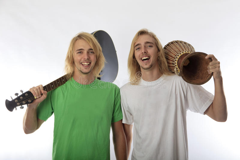 Twin brothers with their guitar and drum