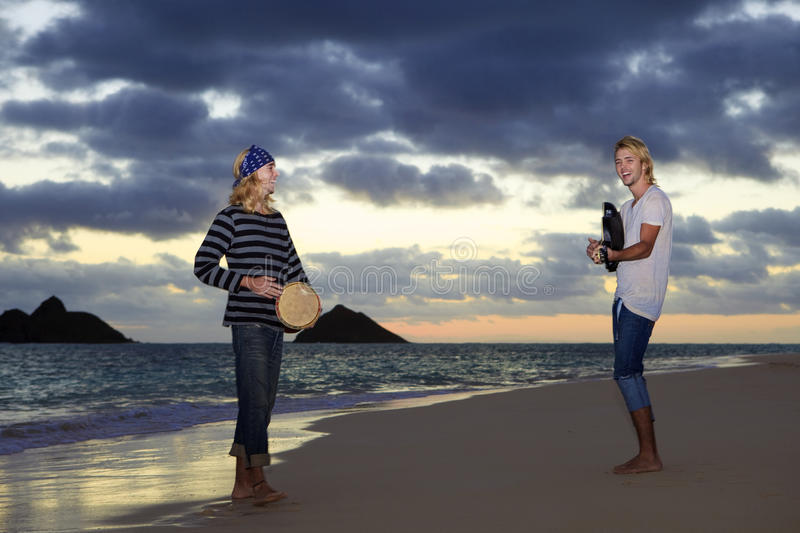 Download Twin Brothers With Their Guitar And Drum Stock Photo - Image of male, daybreak: 12565402