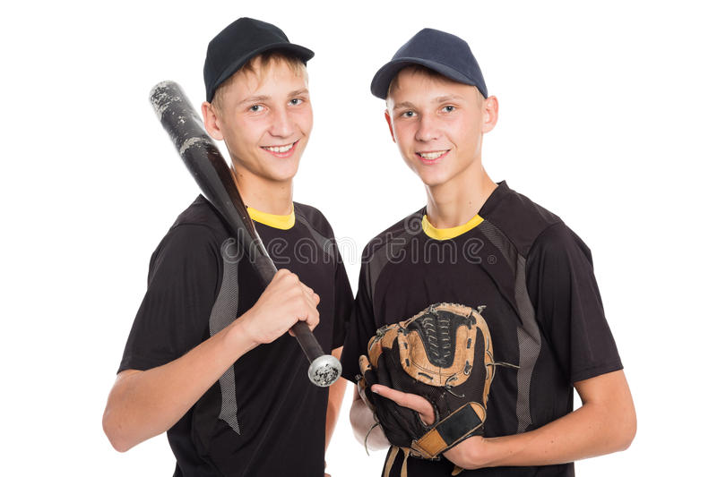 Twin brothers - young baseball players stock images