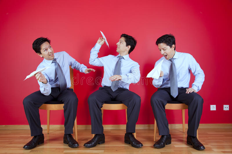 Twin businessman trowing paper planes royalty free stock photography