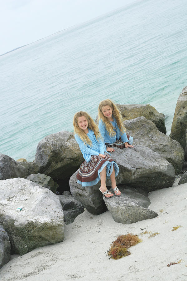 Free Twin Children Playing On Rocks At The Beach Stock Photos - 14173243