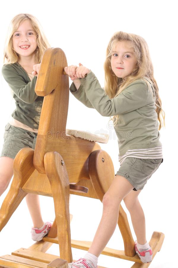 Twin children sharing royalty free stock photos