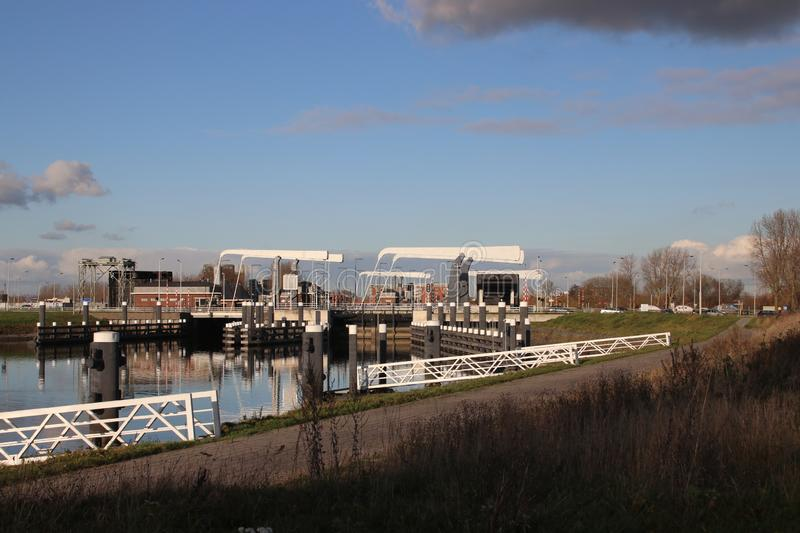 Twin double sluice named Julianasluis at river Gouwe in Gouda, The Netherlands. Twin double sluice named Julianasluis at river Gouwe in Gouda, The Netherlands royalty free stock photos
