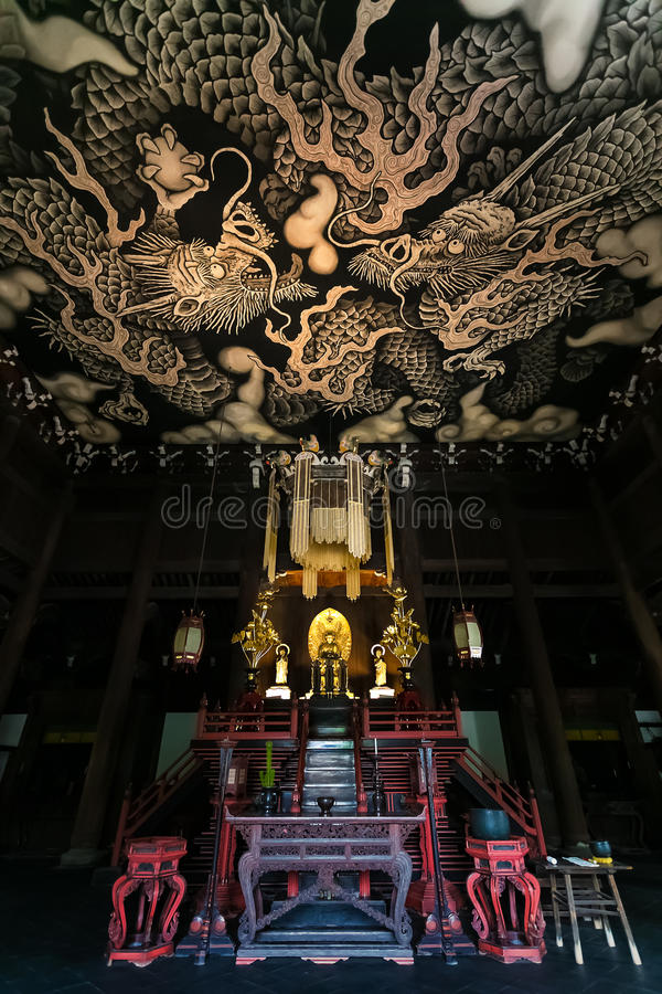 Twin Dragons painting on the ceiling at Kennin-ji temple. Twin Dragons painting on the ceiling of the main hall commemorates the 800-year founding anniversary of stock photo