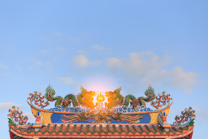 Twin dragons statue on the roof of Chinese temple stock photo