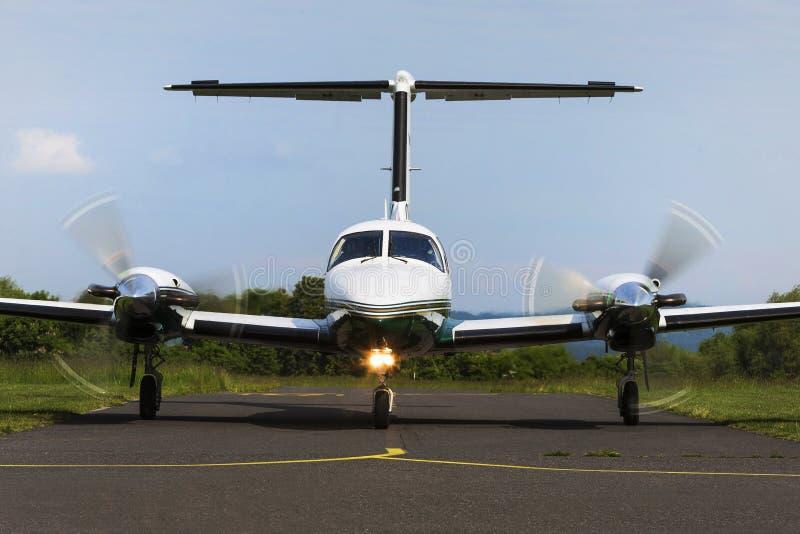 Twin-engine piston aircraft. Small private twin-engine piston aircraft on runway stock photo