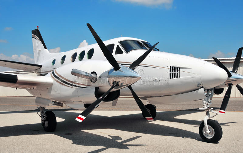 Twin Engine plane on tarmac. Twin engine plane sitting on tarmac waiting for scheduled maintenance and numbering royalty free stock image