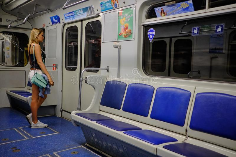 A twin-engine turbojet aircraft AN-148One girl in an empty metro car. At a later time in the subway few passengers royalty free stock photo