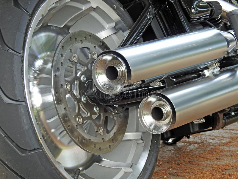 Twin exhaust brake disc detail of harley davidson royalty free stock image