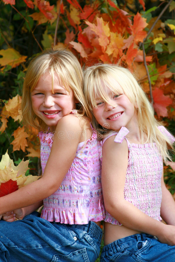 Twin girls stock photos