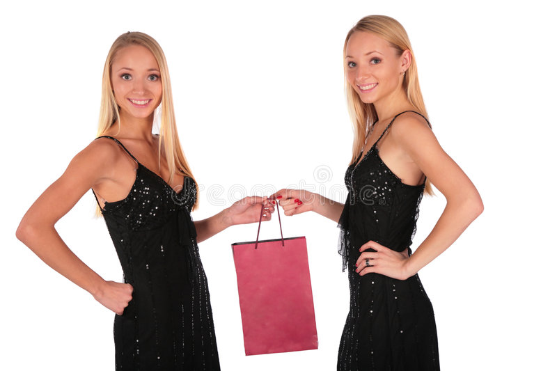Twin Girls Holding Small Bag Stock Photo