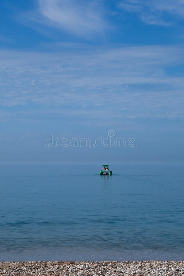 Twin-hull boat. With two people in the sea stock photos