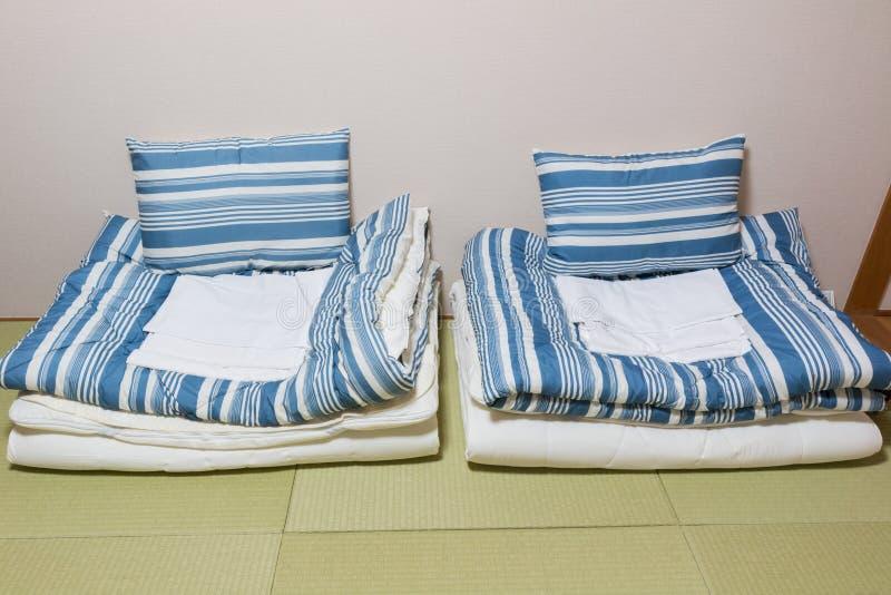 Twin mattress on Tatami mat. Japanese style royalty free stock photo