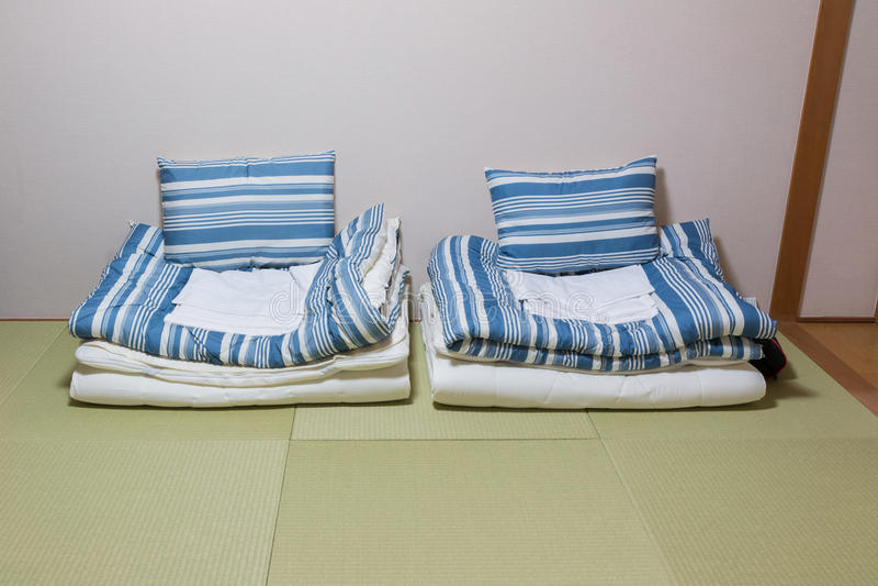 Twin mattress on Tatami mat. Japanese style royalty free stock image