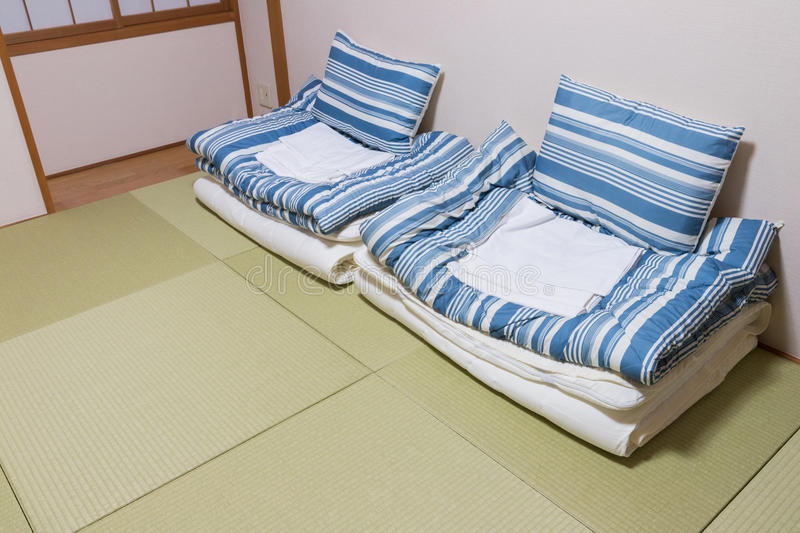 Twin mattress on Tatami mat. Japanese style royalty free stock images