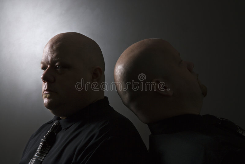 Twin Men Back To Back. Royalty Free Stock Photography