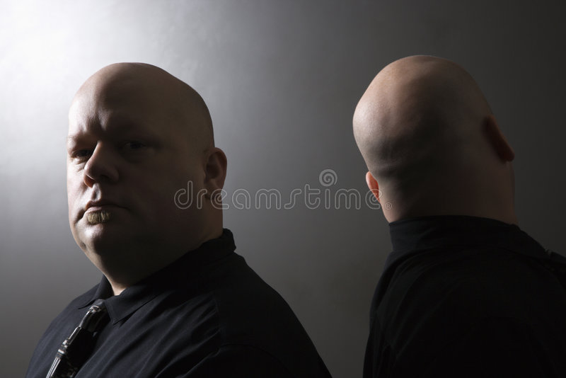 Download Twin men back to back. stock photo. Image of kinship, shot - 2431218