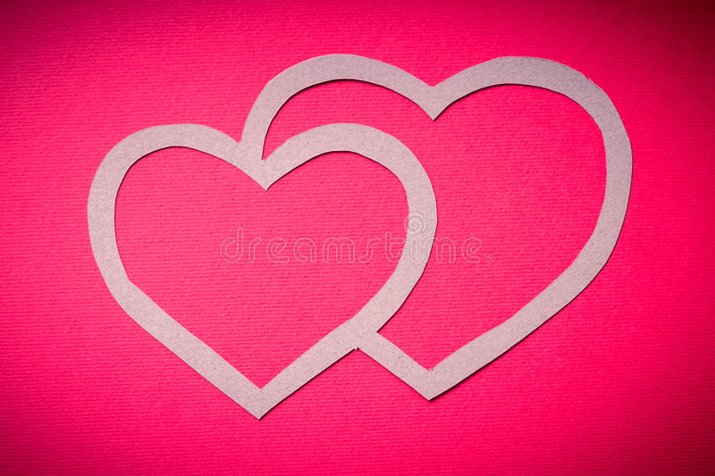 Twin Paper Heart on Red Background stock images