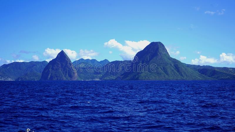 The pitons of saint lucia. Twin pitons, majestically erected on the southwest coast of the island in the city of Soufriere. Listed as a UNESCO World Heritage stock image