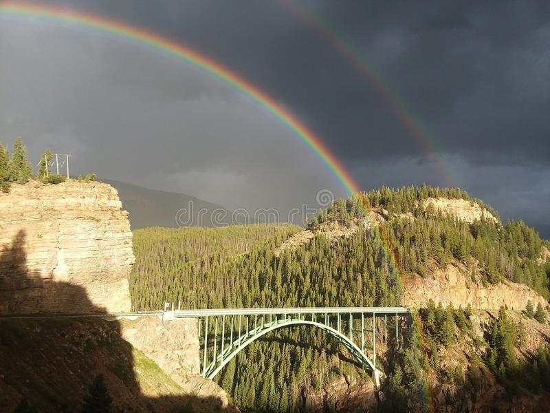 Twin rainbows over Eagle River Bridge colorado. Double Rainbow seen over Eagle River Bridge in Colorado rocky mountains August 2017 after a storm royalty free stock image